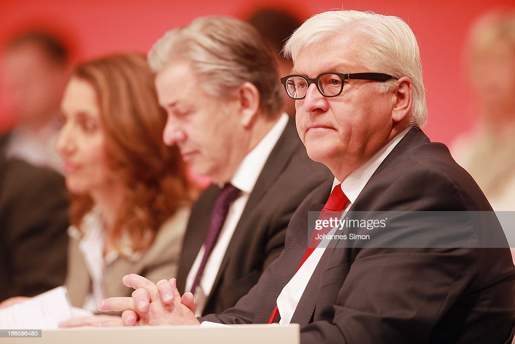 <a gi-track='captionPersonalityLinkClicked' href=/galleries/search?phrase=Frank-Walter+Steinmeier&family=editorial&specificpeople=603500 ng-click='$event.stopPropagation()'>Frank-Walter Steinmeier</a> (R), member of the board of the German Social Democrats (SPD), attends the SPD federal party congress on April 14, 2013 in Augsburg, Germany. Peer Steinbrueck, SPD chancellor candidate will face Chancellor and Christian Democrat (CDU) Angela Merkel in federal elections scheduled for September. So far Steinbrueck's ratings in the polls have lagged far behind those of Merkel following several comments and gaffes on Steinbrueck's part.