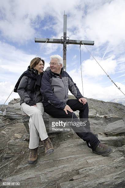 FrankWalter STEINMEIER SPD Federal Minister of Foreign Affairs and his wife Elke Buedenbender are sitting on the peak of the Wilde Kreuzspitze during...