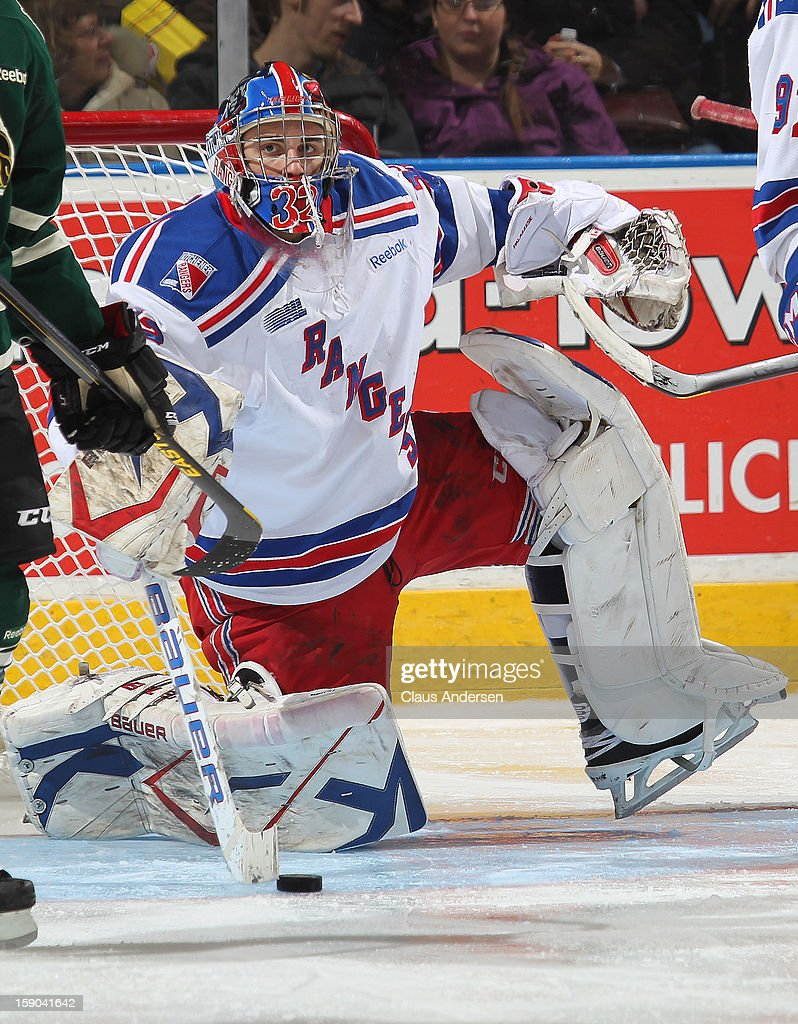 Franky Palazzese #32 of the Kitchener Rangers gets up after making a stop in an OHL game against the London Knights on January 5, 2013 at the Budweiser Gardens in London, Canada. The Knights defeated the Rangers 3-2.