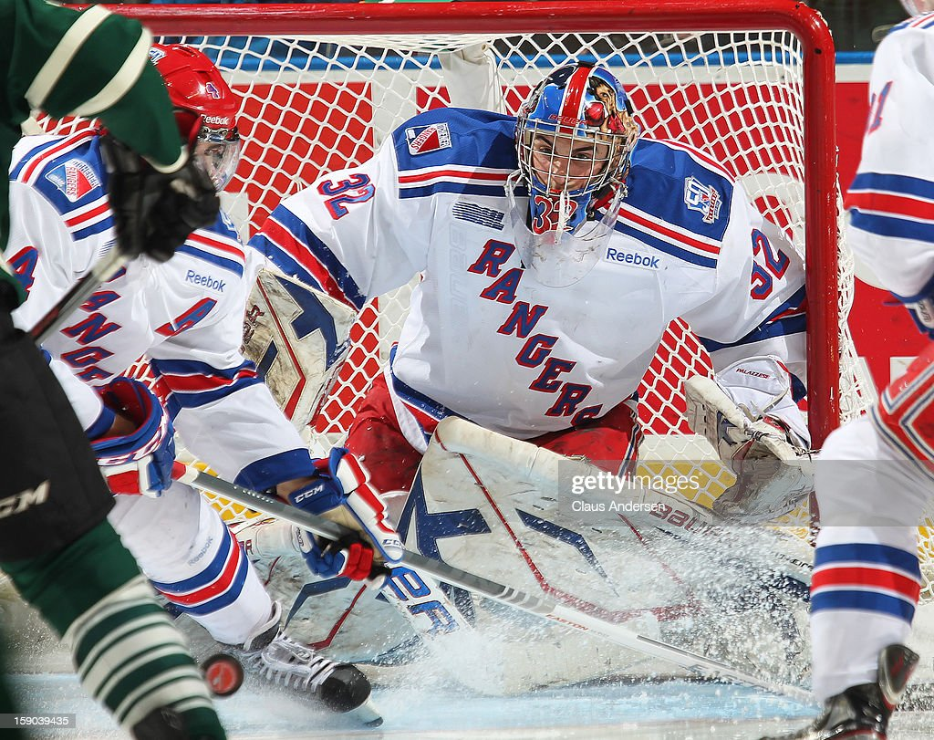 Franky Palazzese #32 of the Kitchener Rangers keeps an eye on the puck in an OHL game against the London Knights on January 5, 2013 at the Budweiser Gardens in London, Canada. The Knights defeated the Rangers 3-2.