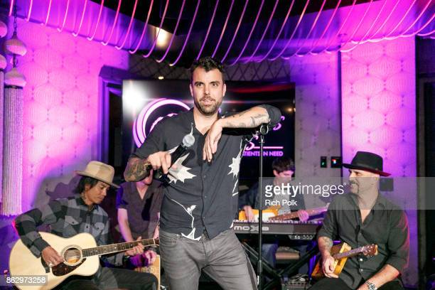 Franky Perez and Dave Kushner perform on stage with the Hellcat Saints at An Evening With Rhonda's Kiss Charity at Beauty Essex on October 18 2017 in...