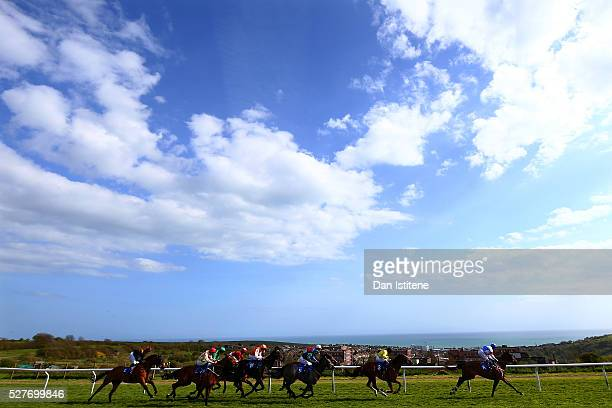 Franny Norton leads the field riding Togetherwecan during the letsdobusinessorg Brighton 12 May Classified Stakes at Brighton Racecourse on May 3...