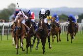 Franny Norton riding Mango Diva win The EBF Fund Upavon Fillies' Stakes at Salisbury racecourse on August 14 2013 in Salisbury England