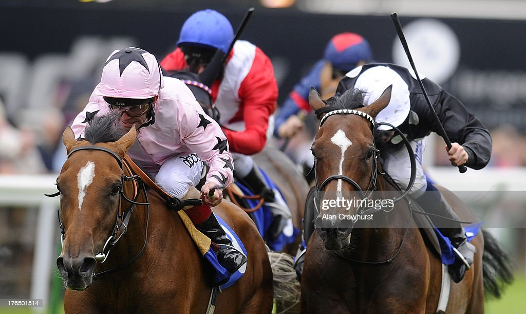 Franny Norton riding Mango Diva (pink) win The EBF Fund Upavon Fillies' Stakes at Salisbury racecourse on August 14, 2013 in Salisbury, England.
