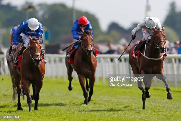 Franny Norton riding Permian win The Betfred Dante Stakes at York racecourse on May 18 2017 in York England