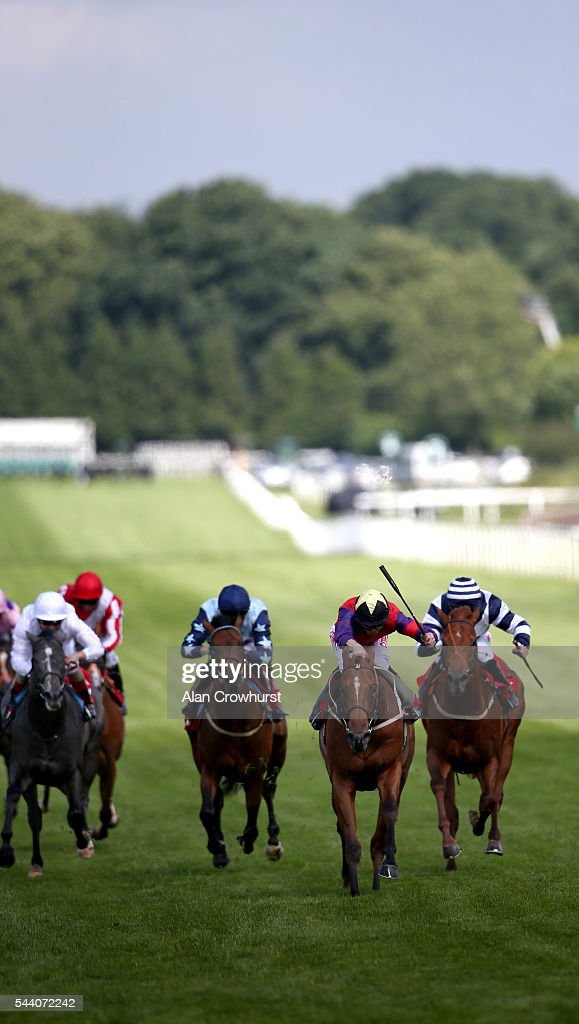 Franny Norton riding The Last Lion (2R, red) win The RacingUK/Daypass Dragon Stakes at Sandown Park on July 01, 2016 in Esher, England.