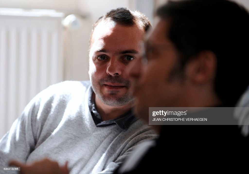 François Lambert (L), the nephew of a 38-year-old quadriplegic Vincent Lambert who is being kept artificially alive, attends the appeal trial at the administrative court of Nancy on May 26, 2016. The administrative court examines on May 26, 2016 the request of his nephew to end artificial life support for his uncle Vincent Lambert who is at the CHU of Reims. Lambert suffers from irreversible brain damage and is in a chronic vegetative state since a road accident in 2008. While his wife, nephew and doctors approve a 'passive' form of euthanasia and the withdrawal of artificial life support, Lambert's parents have refused to accept it and have fought several legal battles to keep their son on life support. / AFP / Jean Christophe VERHAEGEN