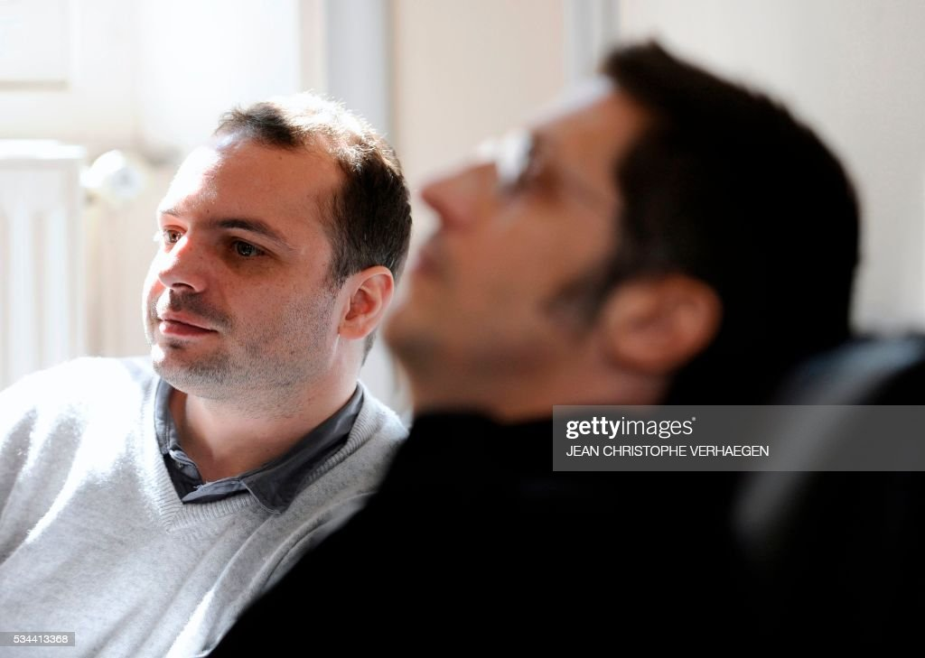 François Lambert (L), the nephew of a 38-year-old quadriplegic Vincent Lambert who is being kept artificially alive and his lawyer Bruno Lorit (R), speak before the appeal trial at the administrative court of Nancy on May 26, 2016. The administrative court examines on May 26, 2016 the request of his nephew to end artificial life support for his uncle Vincent Lambert who is at the CHU of Reims. Lambert suffers from irreversible brain damage and is in a chronic vegetative state since a road accident in 2008. While his wife, nephew and doctors approve a 'passive' form of euthanasia and the withdrawal of artificial life support, Lambert's parents have refused to accept it and have fought several legal battles to keep their son on life support. / AFP / Jean Christophe VERHAEGEN