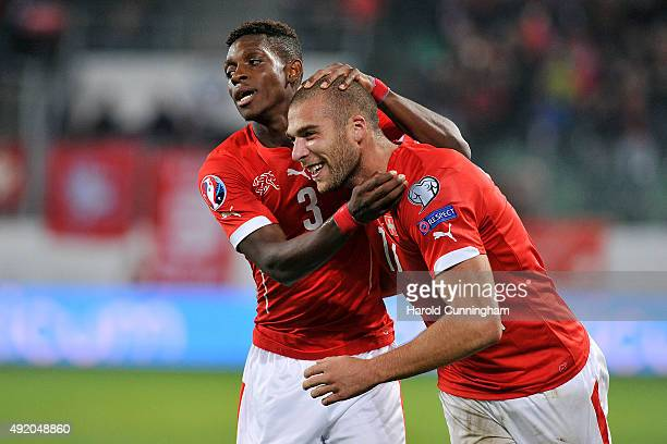 François Moubandje and Pajtim Kasami of Switzerland celebrate scoring the fifth goal during the UEFA EURO 2016 qualifier between Switzerland and San...