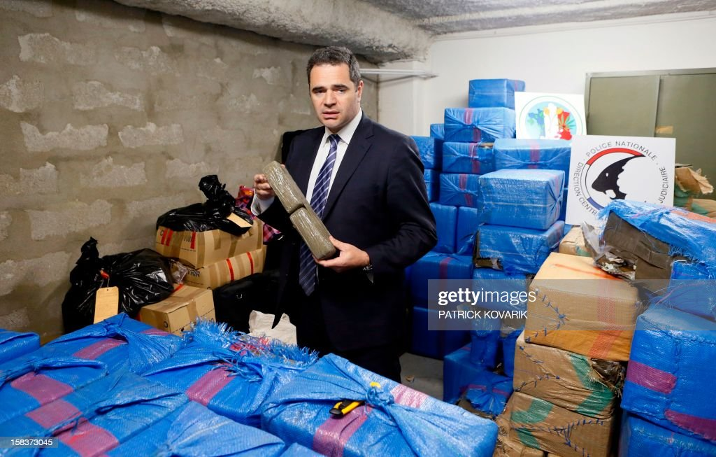 François Thierry, head of the French Central Office for the Suppression of Illicit Drugs Trafficking, presents 2.5 tons of cannabis resin seized by French police, on December 14, 2012 in Nanterre, outside Paris.