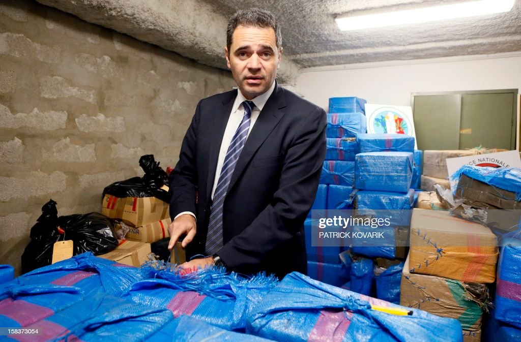 François Thierry, head of the French Central Office for the Suppression of Illicit Drugs Trafficking, presents 2.5 tons of cannabis resin seized by French police, on December 14, 2012 in Nanterre, outside Paris. AFP PHOTO / PATRICK KOVARIK