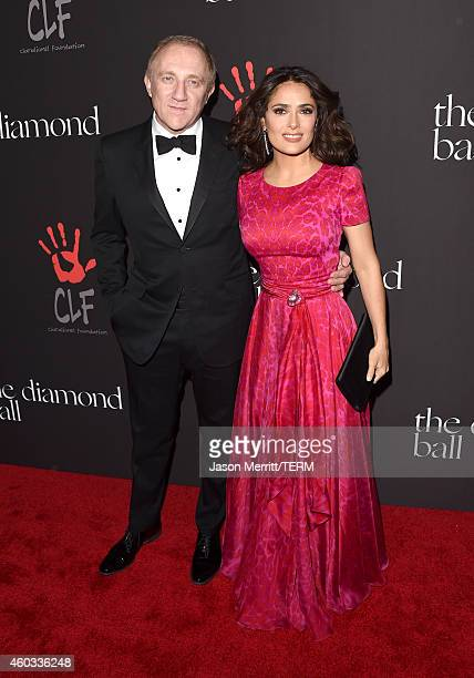 FrançoisHenri Pinault and actress Salma Hayek attend Rihanna's First Annual Diamond Ball at The Vineyard on December 11 2014 in Beverly Hills...