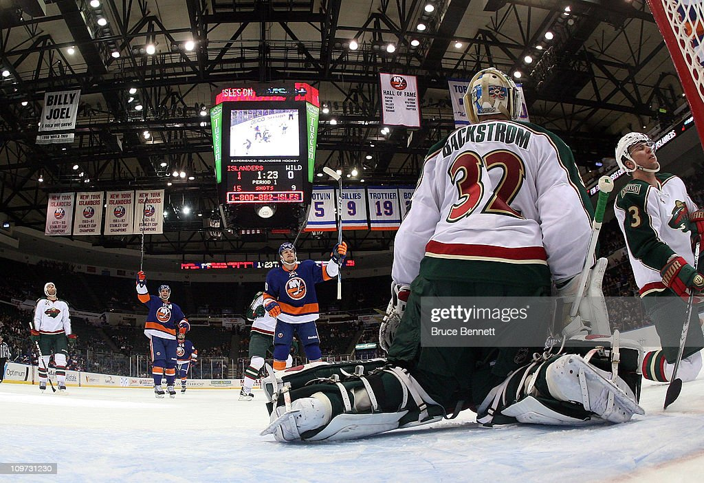 Frans Nielsen and Michael Grabner celebrate a first period goal by Kyle Okposo of the New York Islanders against the Minnesota Wild at the Nassau...