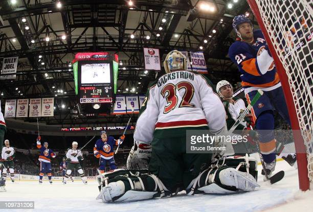 Frans Nielsen Michael Grabner and Kyle Okposo of the New York Islanders celebrate Okposo's first period goal against the Minnesota Wild at the Nassau...