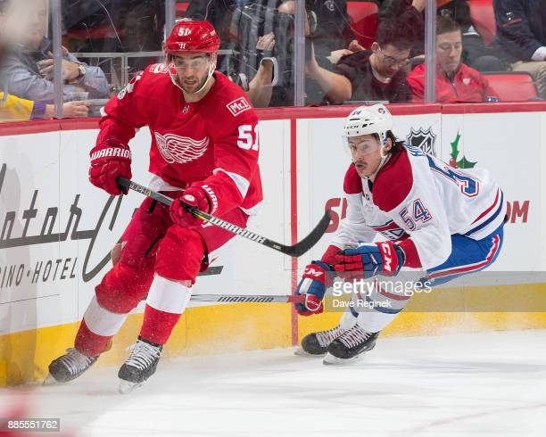 Frans Nielsen of the Detroit Red Wings follows the play in front of Charles Hudon of the Montreal Canadiens during an NHL game at Little Caesars...