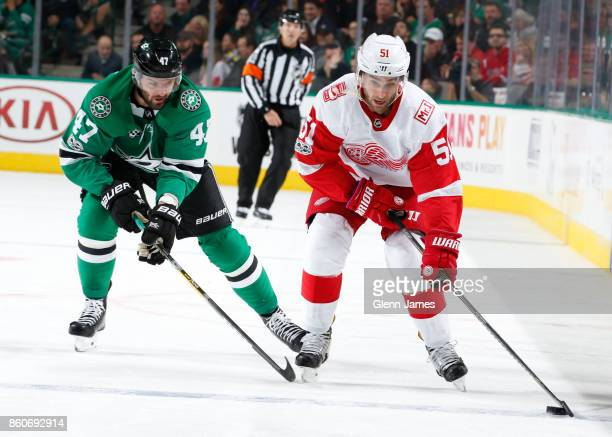 Frans Nielsen of the Detroit Red Wings handles the puck against Alexander Radulov of the Dallas Stars at the American Airlines Center on October 10...