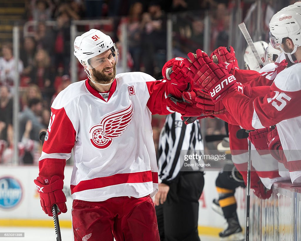 Frans Nielsen #51 of the Detroit Red Wings pounds gloves with teammates on the bench following his game winning shoot-out goal during an NHL game against the Boston Bruins at Joe Louis Arena on January 18, 2017 in Detroit, Michigan. The Wings defeated the Bruins 6-5 in a shoot-out.