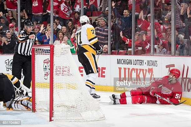 Frans Nielsen of the Detroit Red Wings scores a second period goal on MarcAndre Fleury of the Pittsburgh Penguins during an NHL game at Joe Louis...