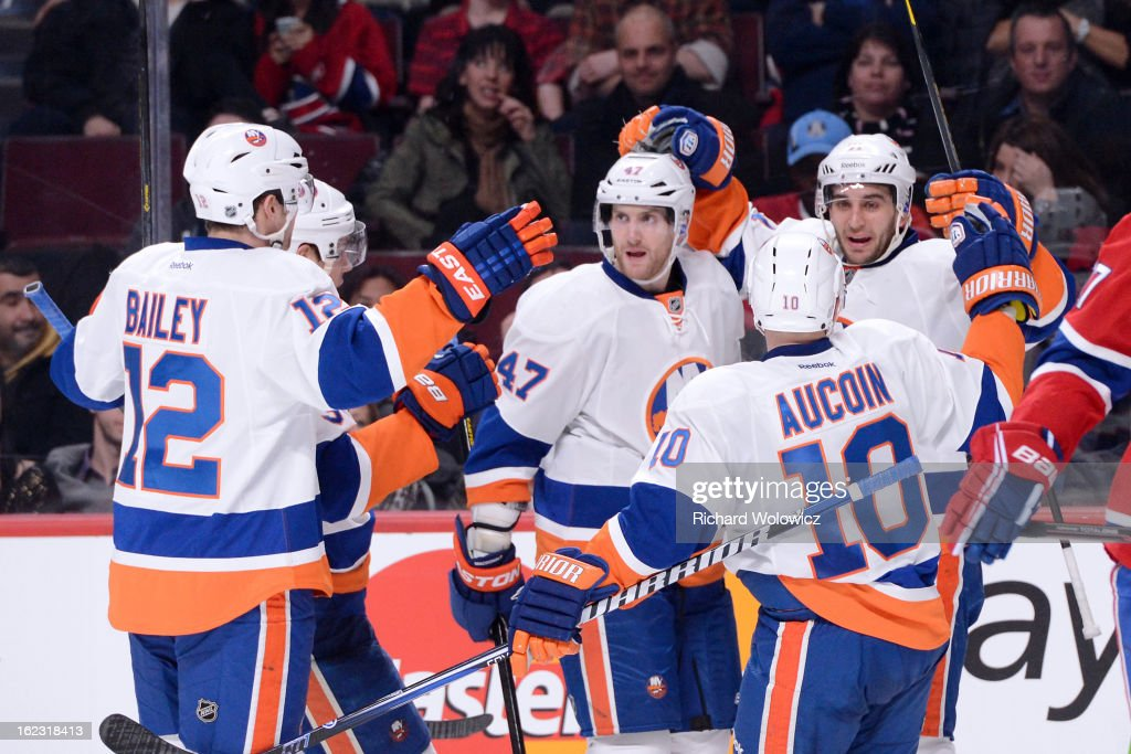 Frans Nielsen #51 of the New York Islanders celebrates his game-tying goal with teammates during the NHL game against the Montreal Canadiens at the Bell Centre on February 21, 2013 in Montreal, Quebec, Canada. The Islanders defeated the Canadiens 4-3 in overtime.