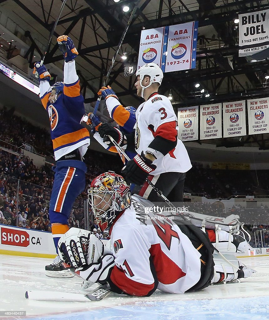 <a gi-track='captionPersonalityLinkClicked' href=/galleries/search?phrase=Frans+Nielsen&family=editorial&specificpeople=634894 ng-click='$event.stopPropagation()'>Frans Nielsen</a> #51 of the New York Islanders celebrates his goal at 22 seconds of the third period against <a gi-track='captionPersonalityLinkClicked' href=/galleries/search?phrase=Craig+Anderson&family=editorial&specificpeople=211238 ng-click='$event.stopPropagation()'>Craig Anderson</a> #41 of the Ottawa Senators at the Nassau Veterans Memorial Coliseum on April 8, 2014 in Uniondale, New York. The Senators defeated the Islanders 4-1.