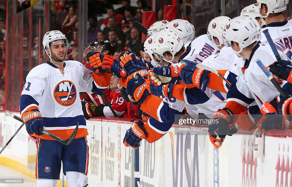 <a gi-track='captionPersonalityLinkClicked' href=/galleries/search?phrase=Frans+Nielsen&family=editorial&specificpeople=634894 ng-click='$event.stopPropagation()'>Frans Nielsen</a> #51 of the New York Islanders celebrates his shoot-out winning goal against the Ottawa Senators at the players' bench at Canadian Tire Centre on November 1, 2013 in Ottawa, Ontario, Canada.