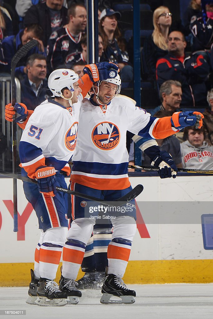 Frans Nielsen #51 of the New York Islanders celebrates with Colin McDonald #13 of the New York Islanders after scoring a first period goal against the Columbus Blue Jackets on November 9, 2013 at Nationwide Arena in Columbus, Ohio.