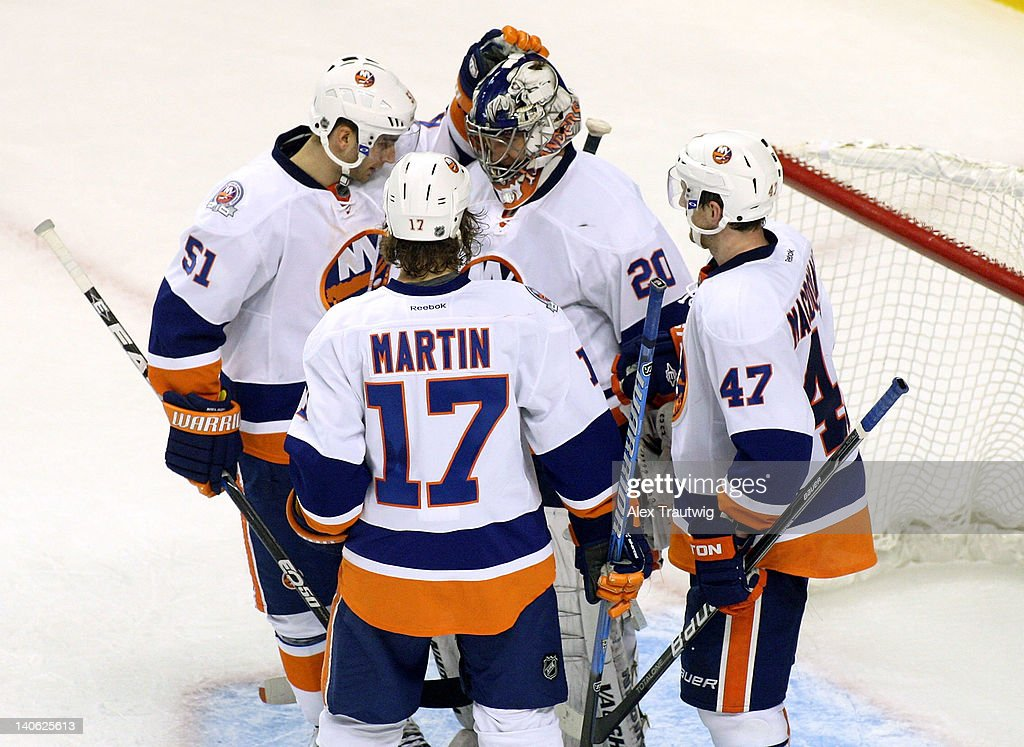 <a gi-track='captionPersonalityLinkClicked' href=/galleries/search?phrase=Frans+Nielsen&family=editorial&specificpeople=634894 ng-click='$event.stopPropagation()'>Frans Nielsen</a> #51 of the New York Islanders congratulates <a gi-track='captionPersonalityLinkClicked' href=/galleries/search?phrase=Evgeni+Nabokov&family=editorial&specificpeople=171380 ng-click='$event.stopPropagation()'>Evgeni Nabokov</a> #20 of the New York Islanders after a 3-2 victory over the Boston Bruins at TD Garden on March 3, 2012 in Boston, Massachusetts.