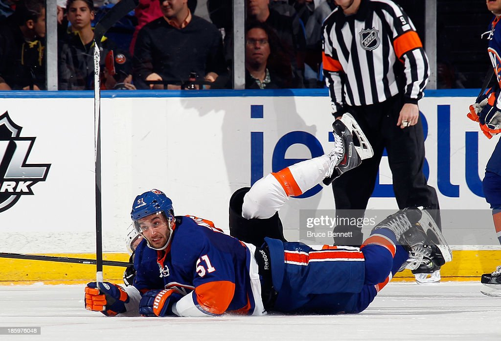 <a gi-track='captionPersonalityLinkClicked' href=/galleries/search?phrase=Frans+Nielsen&family=editorial&specificpeople=634894 ng-click='$event.stopPropagation()'>Frans Nielsen</a> #51 of the New York Islanders hits the ice during the game against the Philadelphia Flyers at the Nassau Veterans Memorial Coliseum on October 26, 2013 in Uniondale, New York. The Flyers defeated the Islanders 5-2.