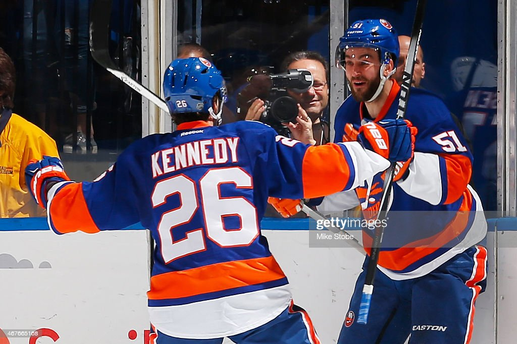 Frans Nielsen #51 of the New York Islanders is congratulated by teammate Tyler Kennedy #26 after scoring a second period goal against the Los Angeles Kings at Nassau Veterans Memorial Coliseum on March 26, 2015 in Uniondale, New York.