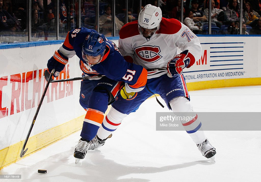 Frans Nielsen #51 of the New York Islanders protects the puck against P.K. Subban #76 of the Montreal Canadiens at Nassau Veterans Memorial Coliseum on March 5, 2013 in Uniondale, New York. The Islanders defeated the Canadiens 6-3.