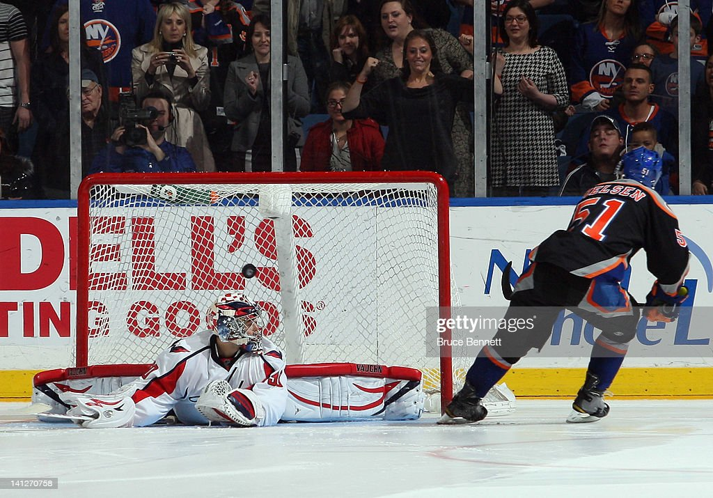 <a gi-track='captionPersonalityLinkClicked' href=/galleries/search?phrase=Frans+Nielsen&family=editorial&specificpeople=634894 ng-click='$event.stopPropagation()'>Frans Nielsen</a> #51 of the New York Islanders scores a shootout goal past <a gi-track='captionPersonalityLinkClicked' href=/galleries/search?phrase=Michal+Neuvirth&family=editorial&specificpeople=3205600 ng-click='$event.stopPropagation()'>Michal Neuvirth</a> #30 of the Washington Capitals at the Nassau Veterans Memorial Coliseum on March 13, 2012 in Uniondale, New York. The Capitals defeated the Islanders 5-4 in the shootout.