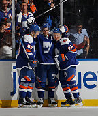 Frans Nielsen of the New York Islanders scores his second goal of the game at 1509 of the third period against the Dallas Stars and is joined by...