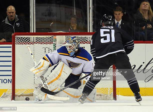 Frans Nielsen of the New York Islanders scores the game winning goal in the shootout against Brian Elliott of the St Louis Blues on December 4 2015...