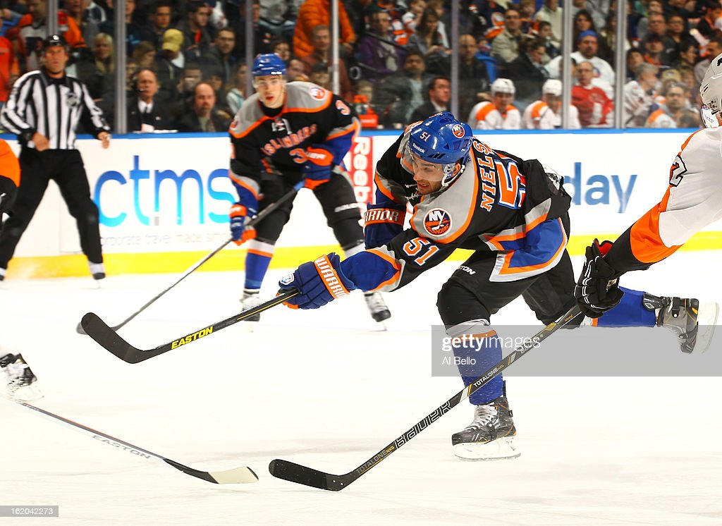 Frans Nielsen #51 of the New York Islanders shoots against the Philadelphia Flyers during their game at Nassau Veterans Memorial Coliseum on February 18, 2013 in Uniondale, New York.