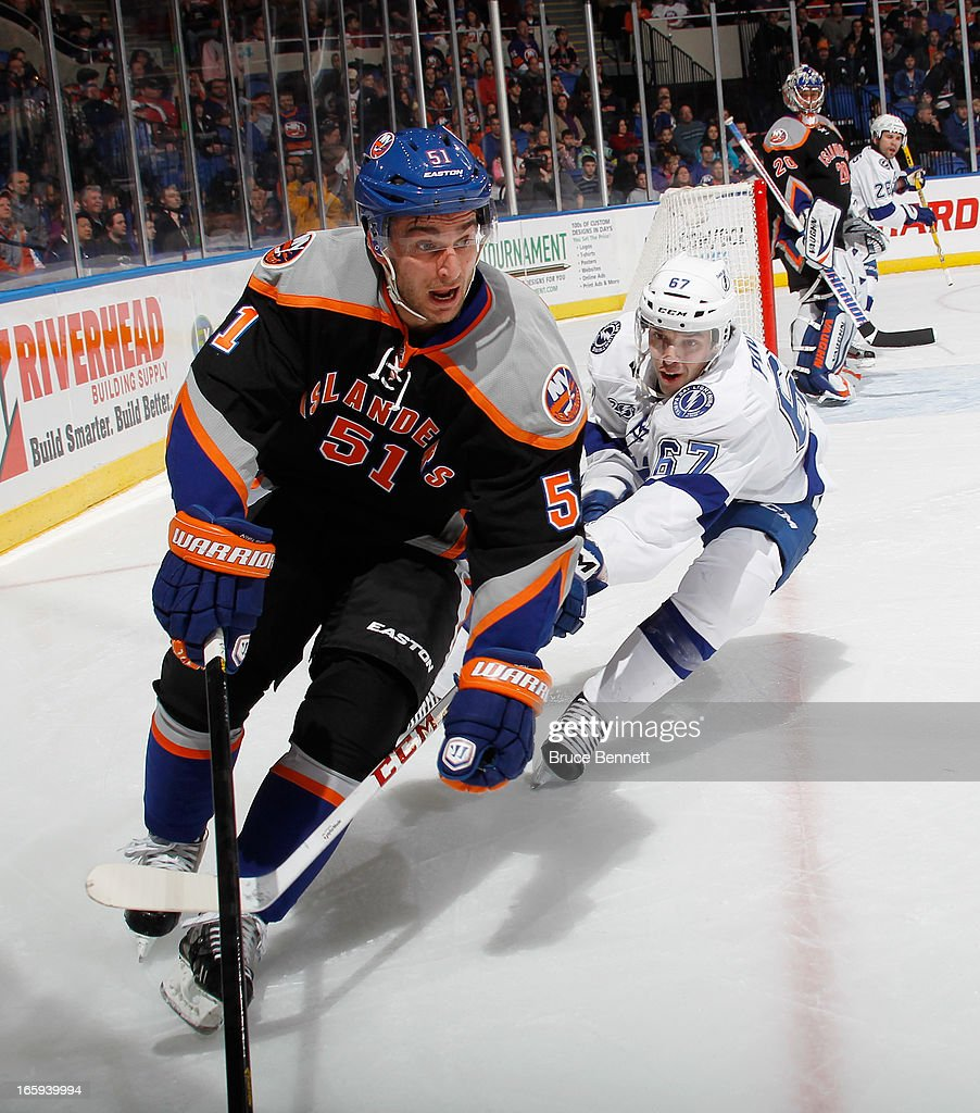 <a gi-track='captionPersonalityLinkClicked' href=/galleries/search?phrase=Frans+Nielsen&family=editorial&specificpeople=634894 ng-click='$event.stopPropagation()'>Frans Nielsen</a> #51 of the New York Islanders skates against the Tampa Bay Lightning at the Nassau Veterans Memorial Coliseum on April 6, 2013 in Uniondale, New York. The Islanders defeated the Lightning 4-2.