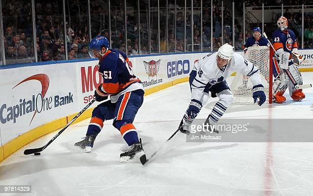 Frans Nielsen of the New York Islanders skates against Wayne Primeau of the Toronto Maple Leafs on March 14 2010 at Nassau Coliseum in Uniondale New...