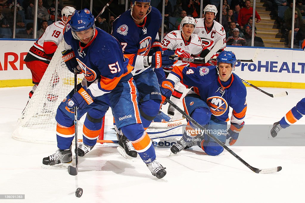 <a gi-track='captionPersonalityLinkClicked' href=/galleries/search?phrase=Frans+Nielsen&family=editorial&specificpeople=634894 ng-click='$event.stopPropagation()'>Frans Nielsen</a> #51 of the New York Islanders skates with the puck as Mark Eaton #4 looks on against the Carolina Hurricanes during their game on February 18, 2012 at the Nassau Coliseum in Uniondale, New York.