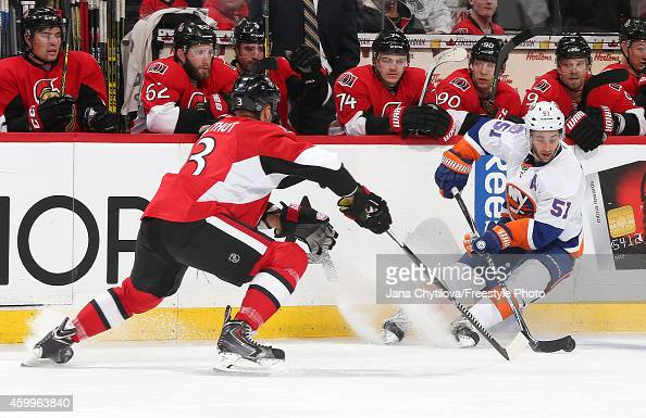 Frans Nielsen of the New York Islanders stickhandles the puck against Marc Methot of the Ottawa Senators in the third period during an NHL game at...