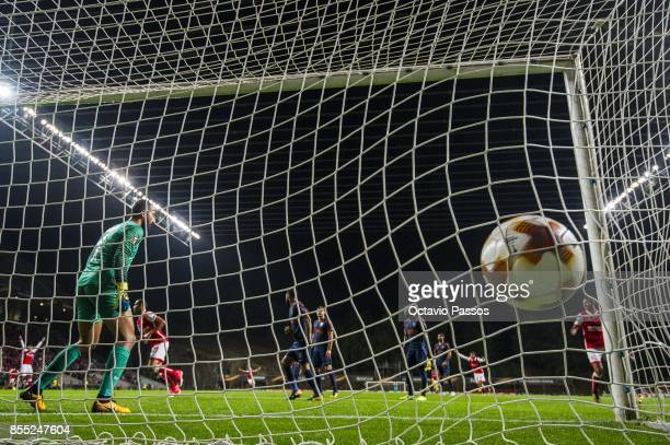 Fransergio of Sporting Braga scores the second goal with Volkan Babacan of Basaksehir FK during the UEFA Europa League group C match between Sporting...