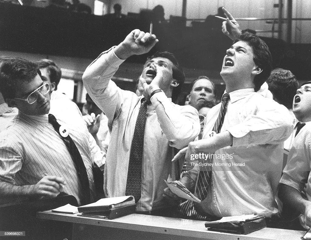 Frantic Trading At Sydney Stock Exchange. Floor Operators At The Sydney  Stock Exchange Yell Instructions