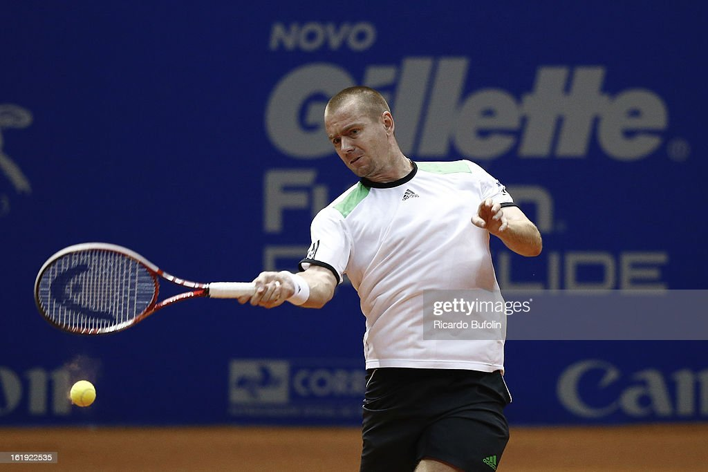 Frantisek Cermak, from Czech Republic, and Michal Mertinak, (on frame) from Slovakia, returns the ball during the double final match against Alexander Peya, from Austria, and Bruno Soares, from Brasil, as part of tenis tournament ATP Brazil Open on February 17, 2013, at Ibirapuera Gymnasium in Sao Paulo, Brazil.