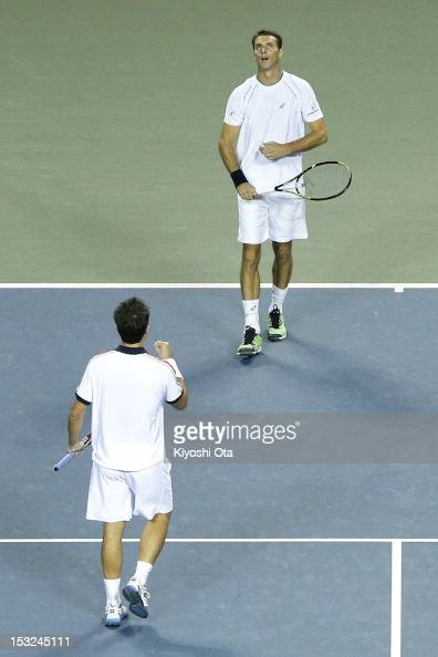 Frantisek Cermak of the Czech Republic celebrate with his teammate Daniele Bracciali of Italy as they win their first round doubles match against...