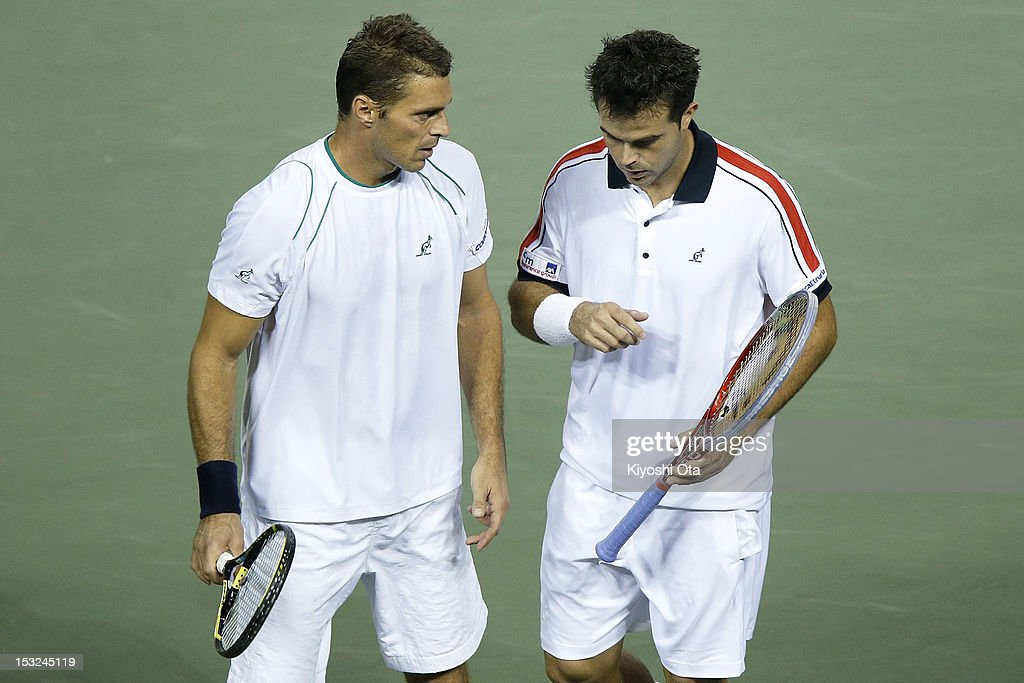 Frantisek Cermak (L) of the Czech Republic speaks to his team-mate Daniele Bracciali of Italy as they play in their first round doubles match against Yuichi Sugita and Yasutaka Uchiyama of Japan during day two of the Rakuten Open at Ariake Colosseum on October 2, 2012 in Tokyo, Japan.