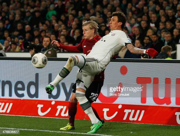 Frantisek Rajtoral of Hannover 96 and Mario Mandzukic of FC Bayern Muenchen fight for the ball during the Bundesliga match between Hannover 96 and FC...
