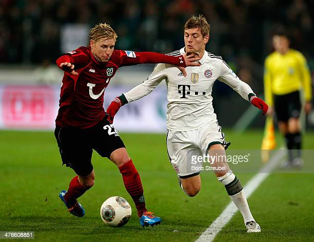 Frantisek Rajtoral of Hannover 96 challenges Toni Kroos of FC Bayern Muenchen during the Bundesliga match between Hannover 96 and FC Bayern Muenchen...