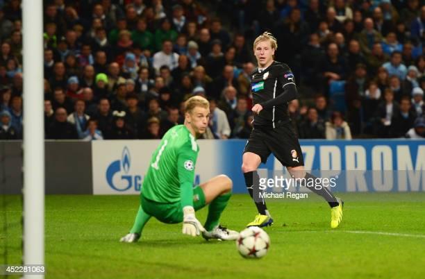 Frantisek Rajtoral of Plzen shoots wide past goalkeeper Joe Hart of Manchester City during the UEFA Champions League Group D match between Manchester...