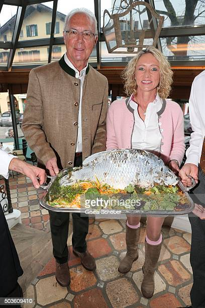 Franz Beckenbauer and his wife Heidi Beckenbauer with fish during the NeujahrsKarpfenessen at Hotel zur Tenne on January 6 2016 in Kitzbuehel Austria