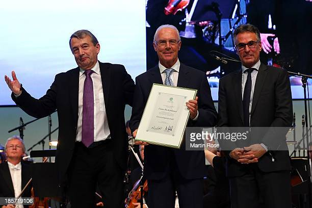 Franz Beckenbauer is presented with the DFB honor membership by DFB president Wolfgang Niersbach and DFB general secretary Helmut Sandrock on October...