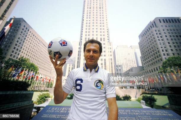 Franz Beckenbauer of the New York Cosmos holds up an official NASL ball in front of the Rockefeller Centre