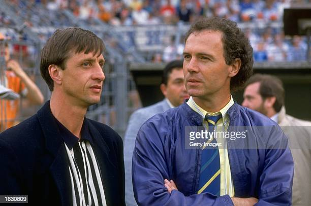 Franz Beckenbauer of West Germany stands with Johan Cruyff of Holland during the European Championship qualifying match between Holland and Hungary...